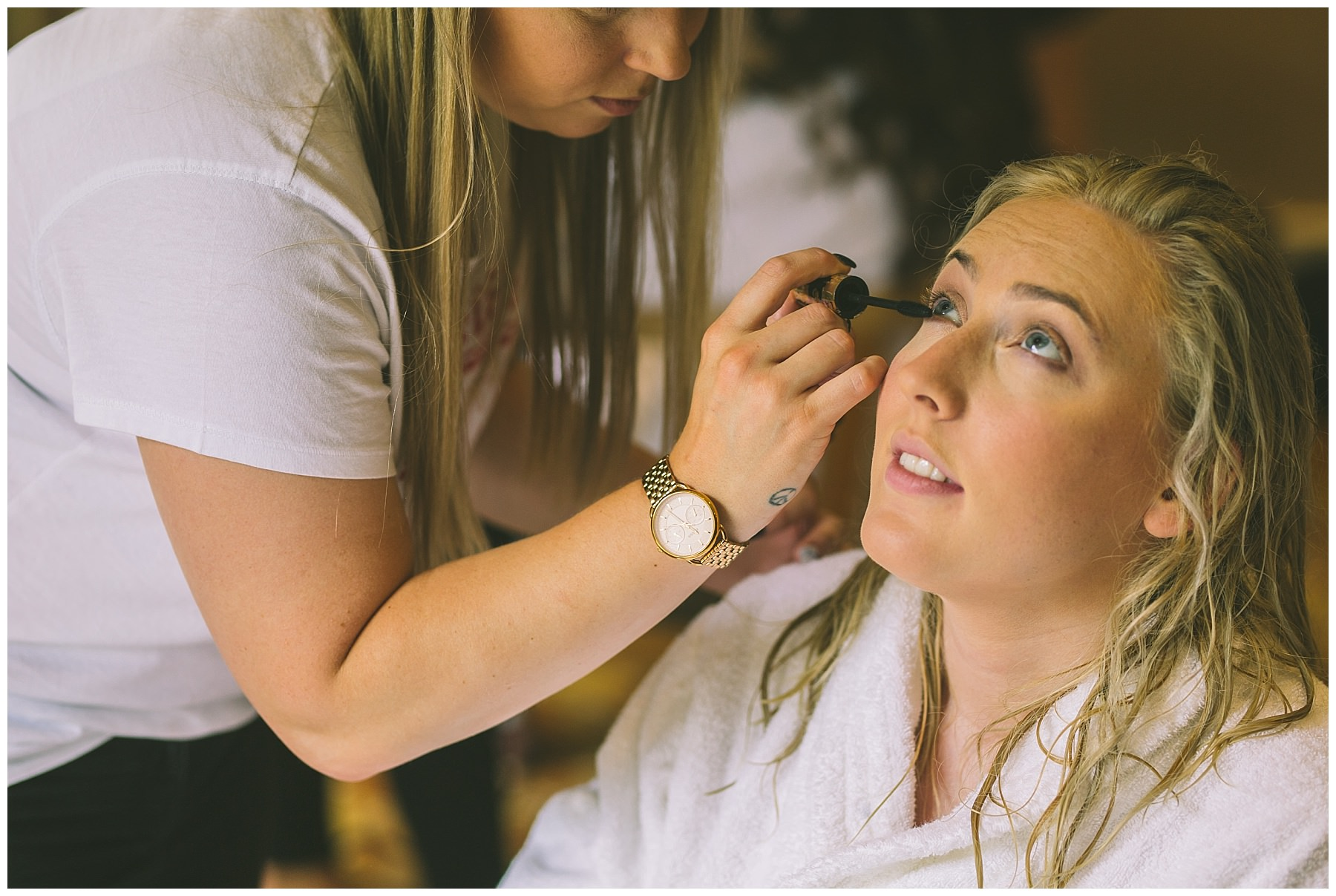 bridal make up being applied for rivington barn wedding
