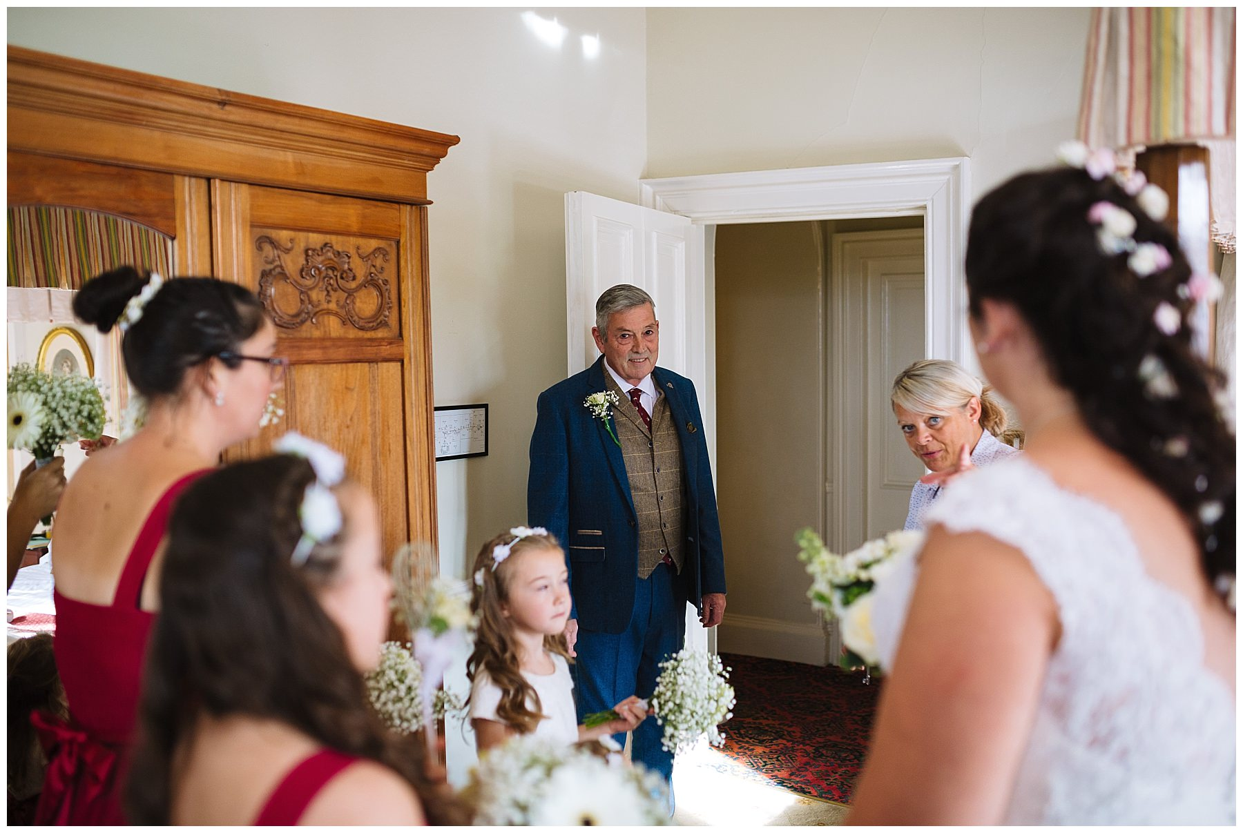 father of the bride looks to daughter during bridal prep