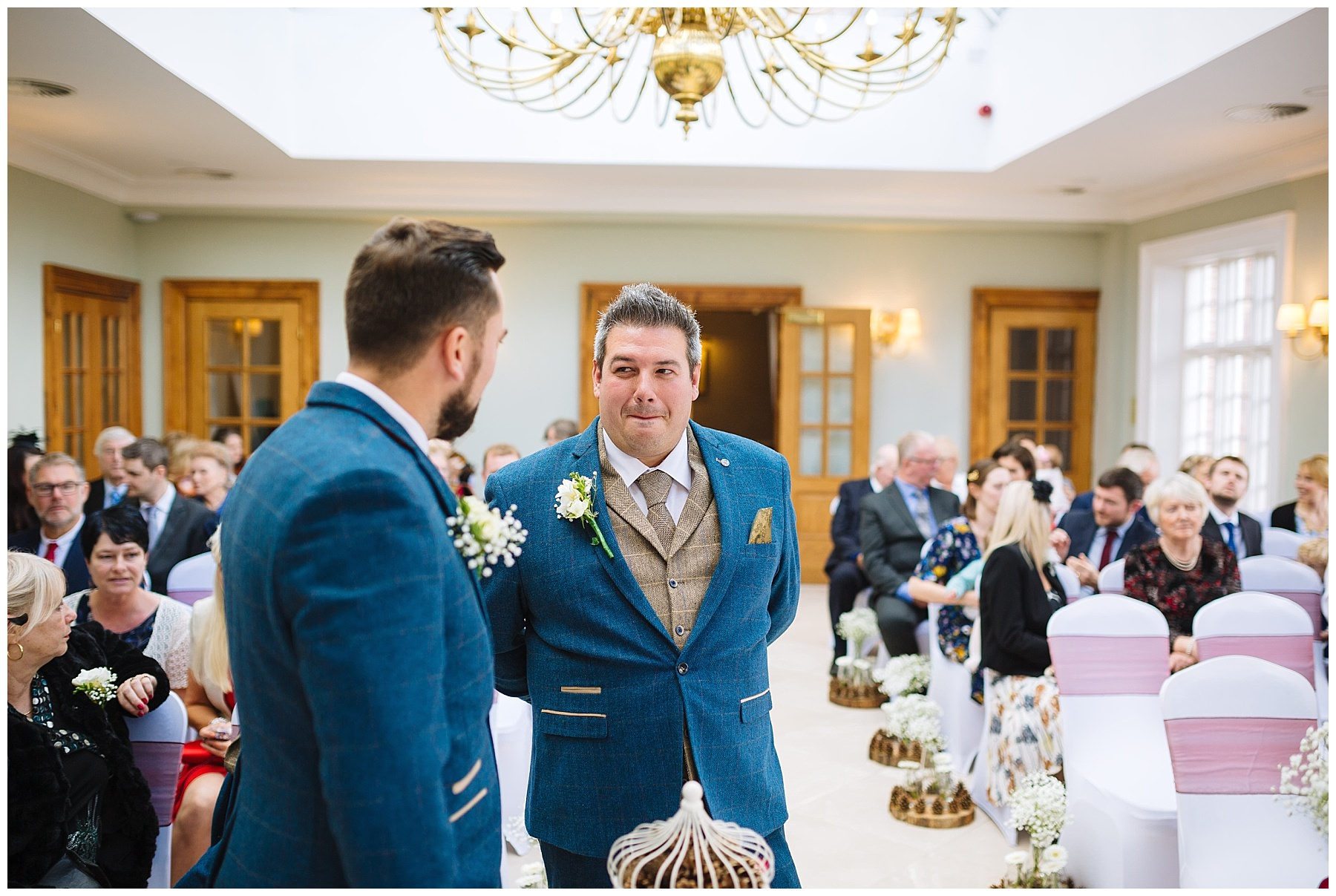 groom waits nervously for his bride at willington hall wedding venue