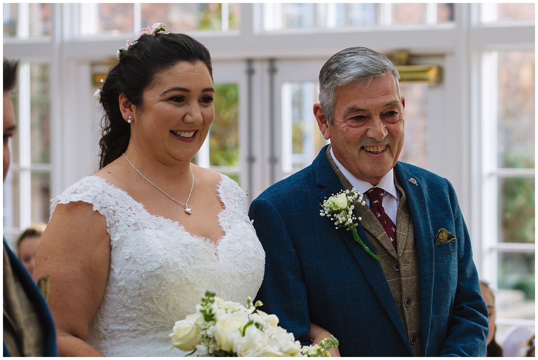 bride and dad smile during willington hall wedding