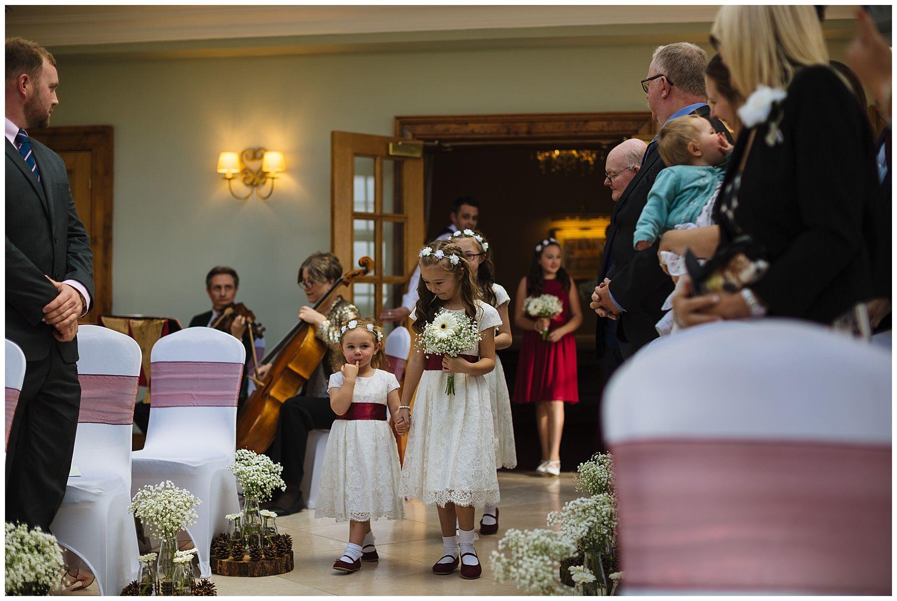 flowergirls arrive for wedding ceremony