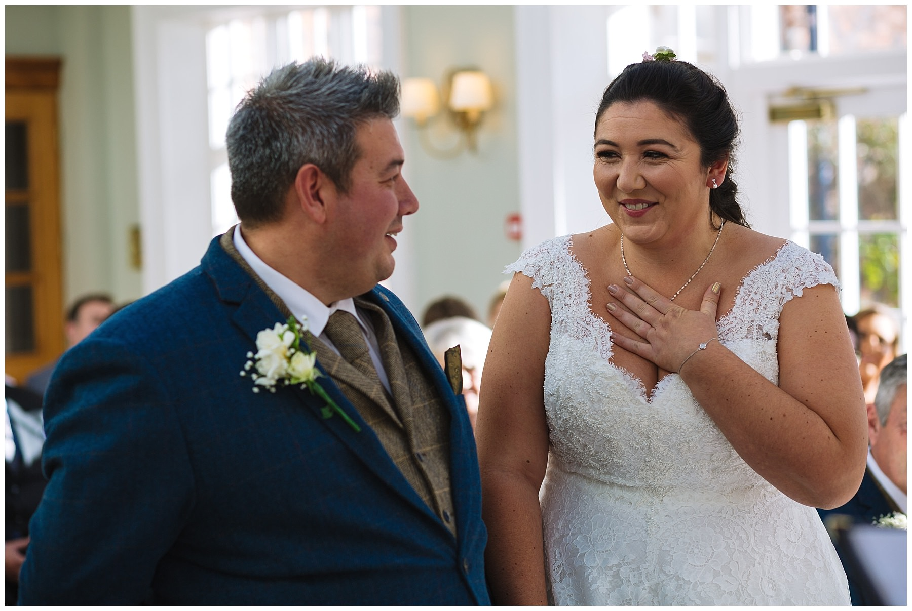 bride laughs during willington hall hotel wedding ceremony