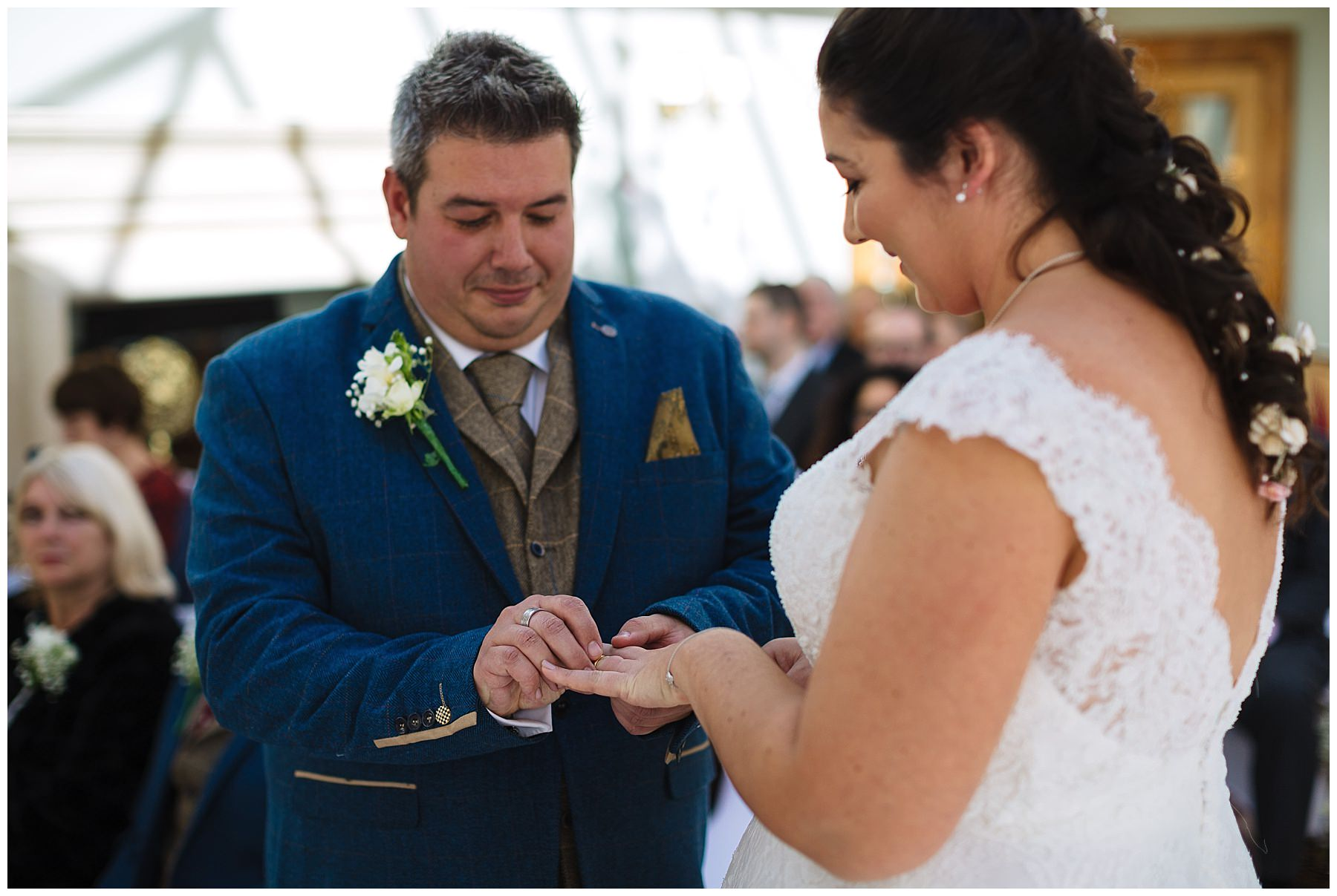 wedding ring exchange during willington hall wedding ceremony