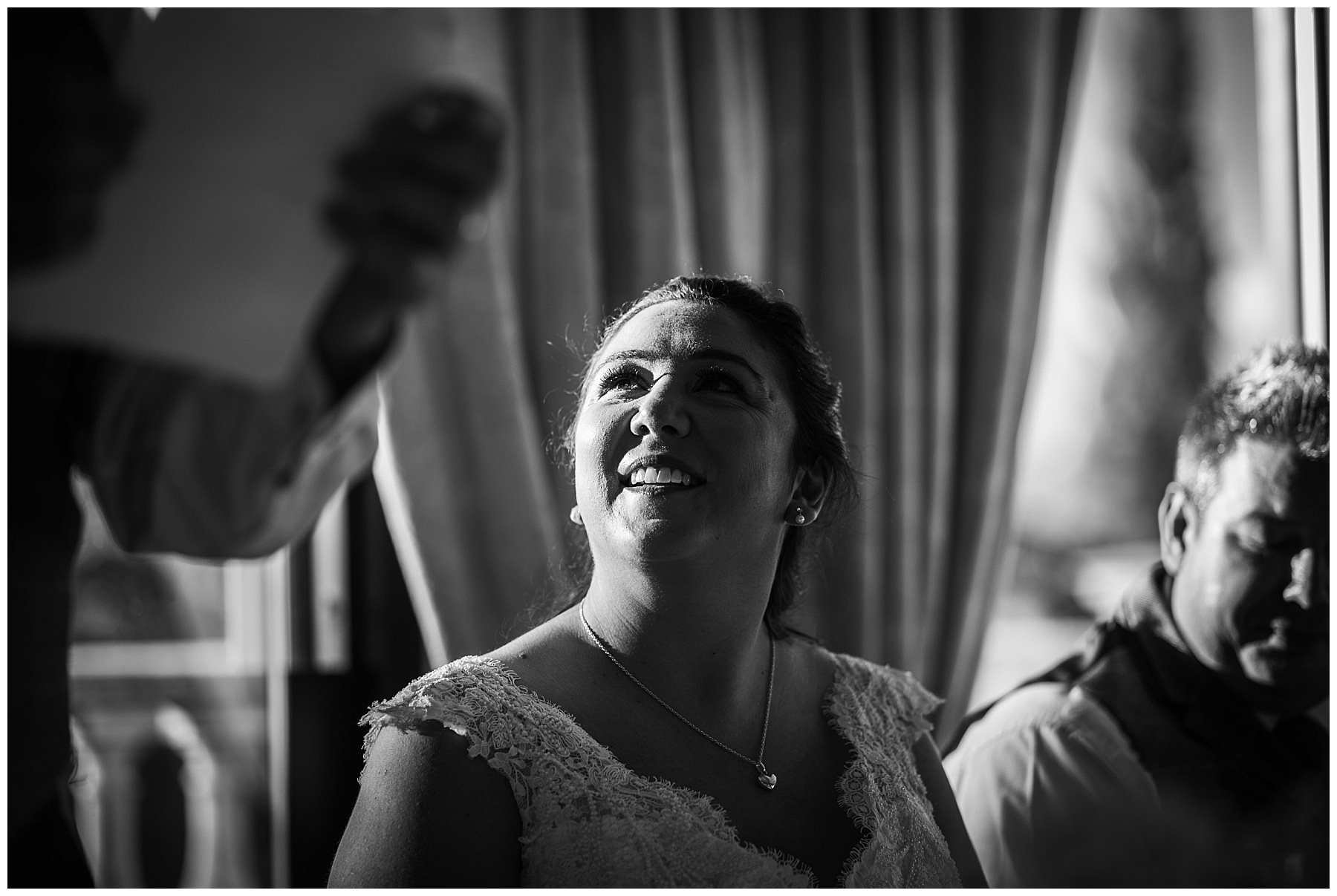 bride looks up to father during his speech