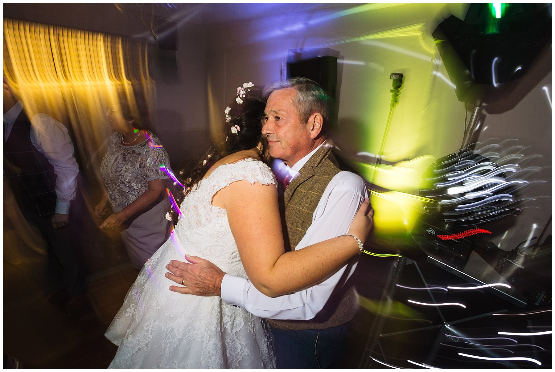 bride hugs dad on the dancefloor at willington hall