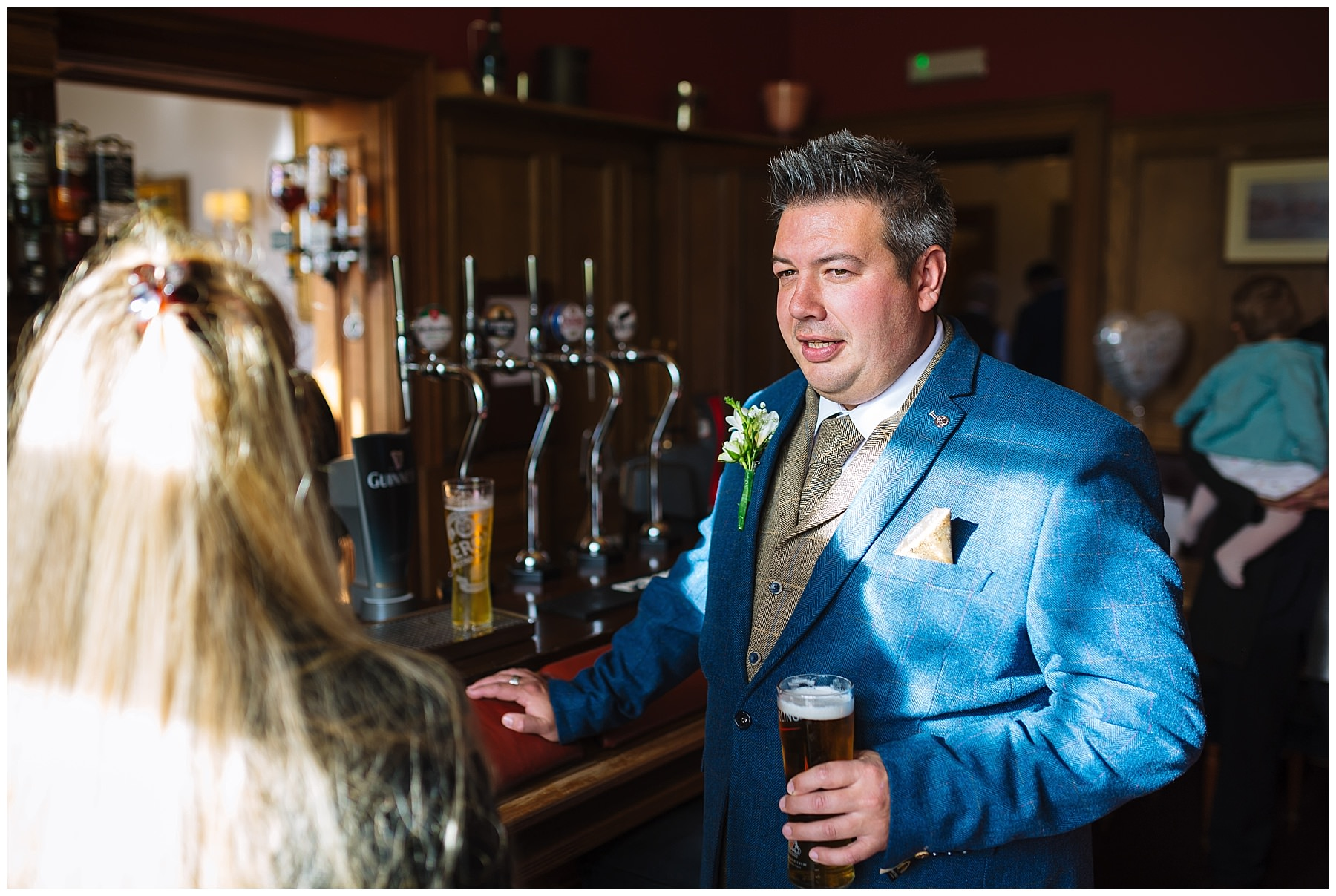 groom enjoys pre wedding pint at willington hall