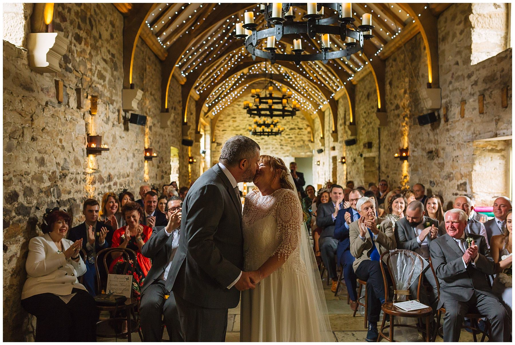 bride and grooms first kiss at the stunning healey barn