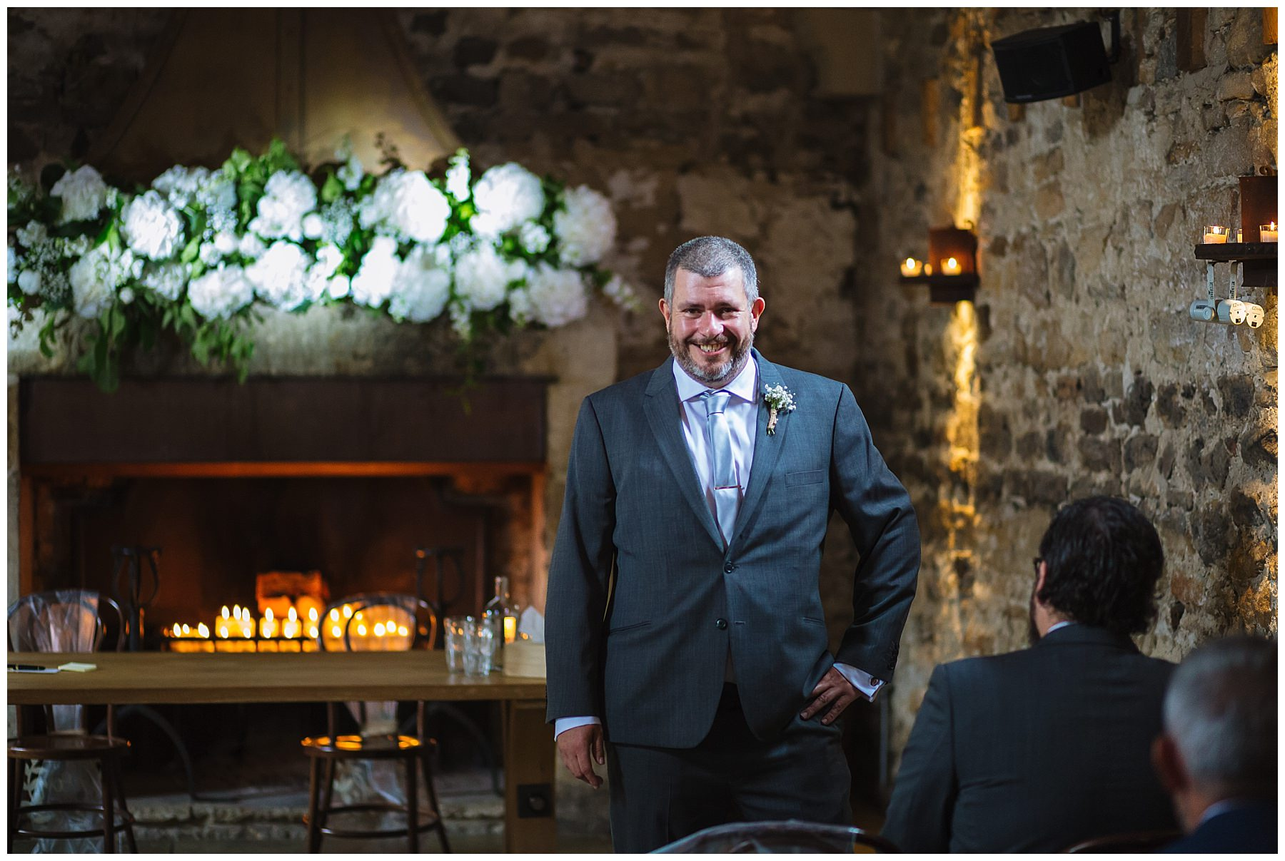 groom at healey barn nervously awaiting his bride