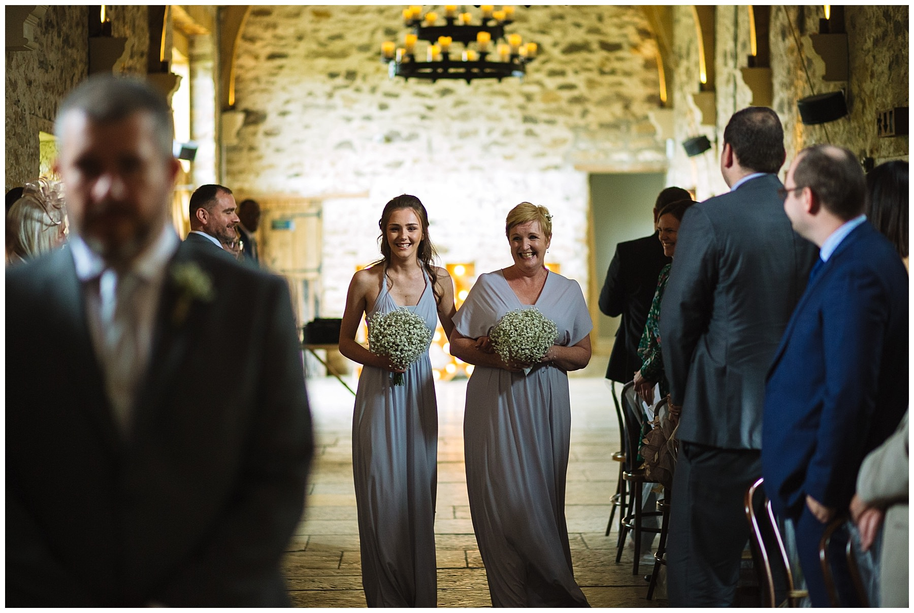bridesmaids arrive for wedding ceremony at healey barn