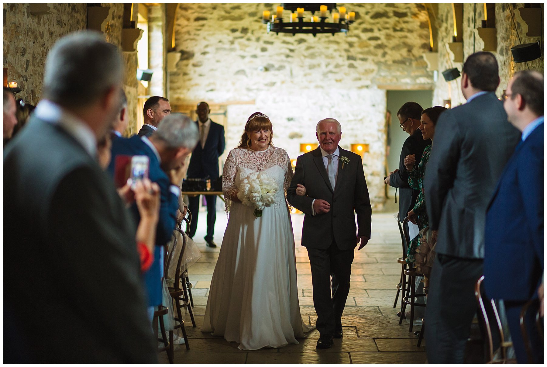 bride and father arrive for healey barn wedding ceremony