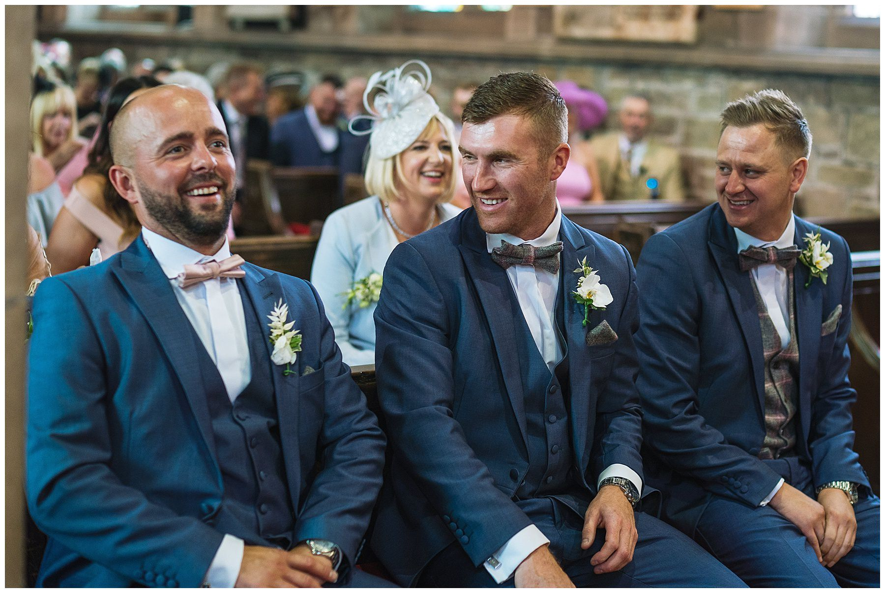 groom and groomsmen in church awaiting brides arrival