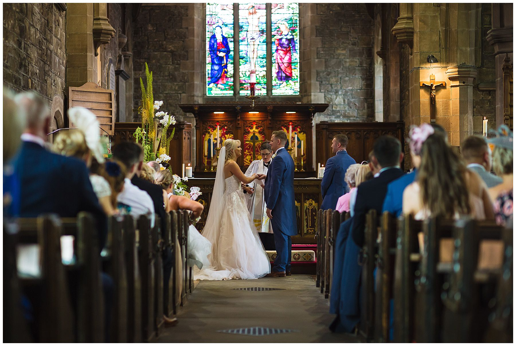 bride and groom exchange vows in stunning beautiful bolton church