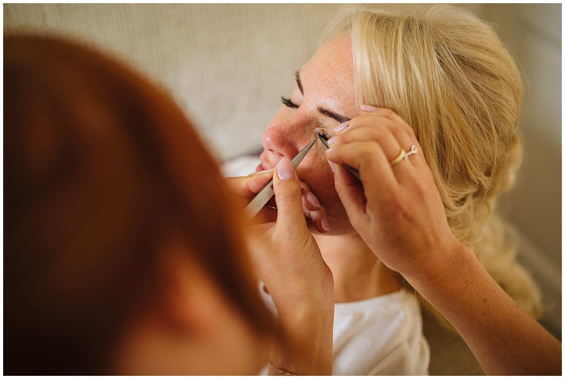 Bride has eyelashes applied
