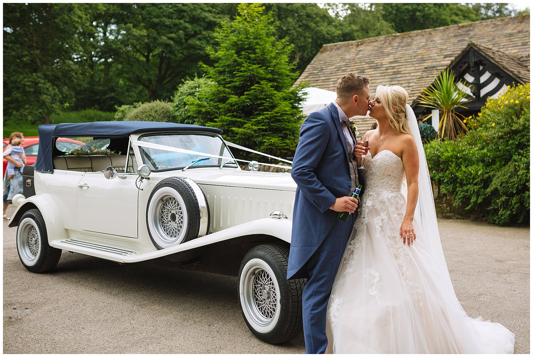bride and groom share a moment as they arrive at rivington barn