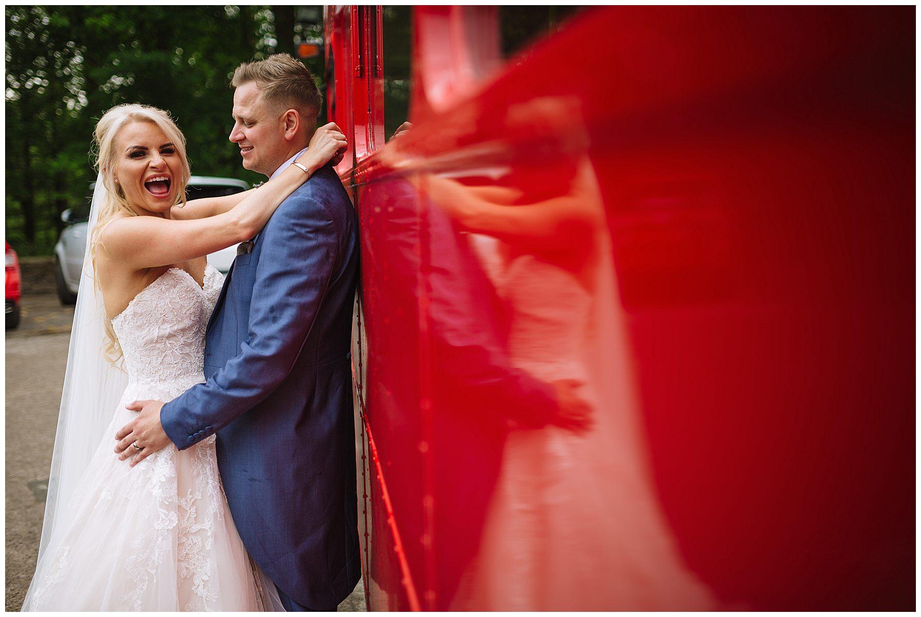 bride and groom laughing during wedding photos at rivington barn