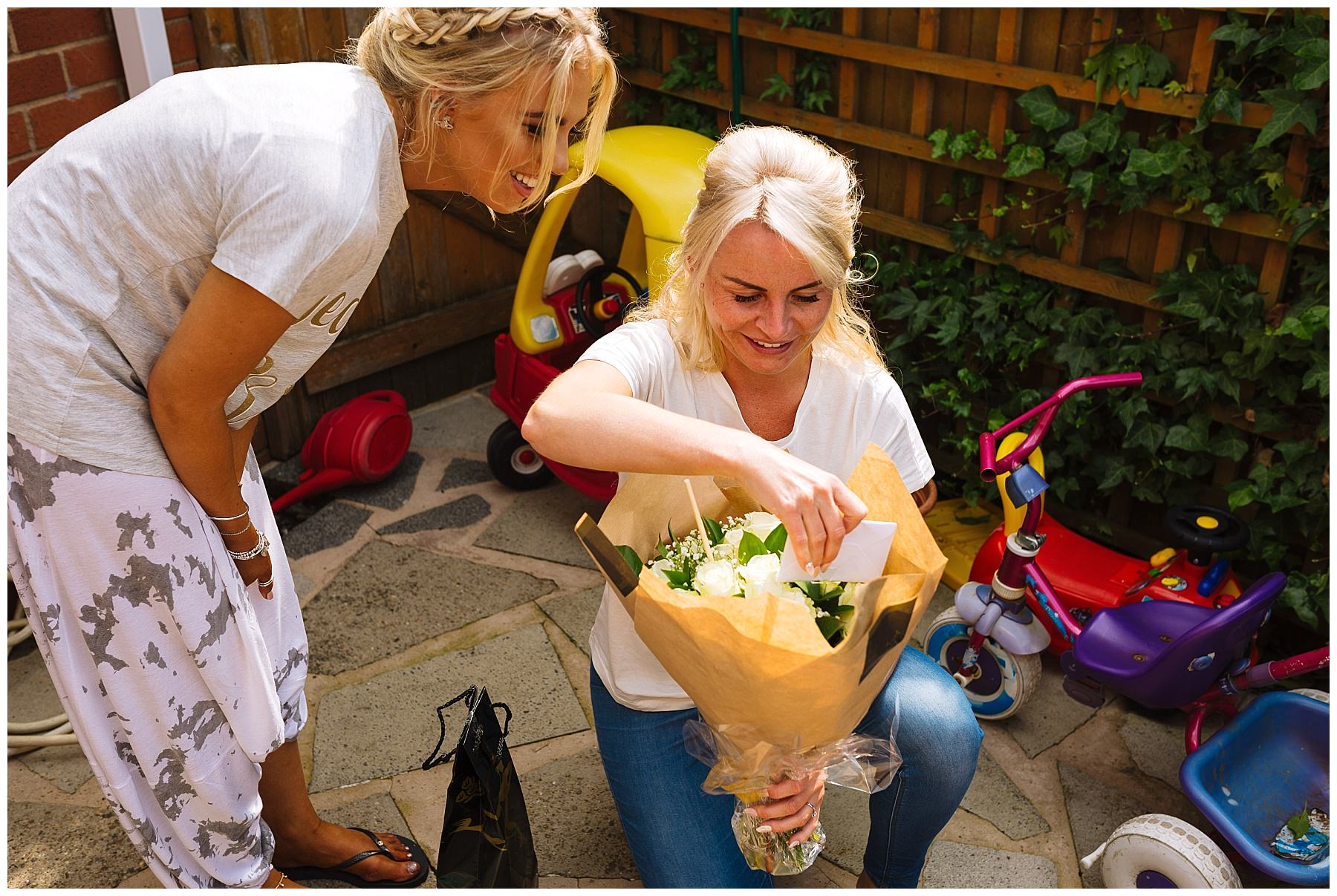 bride receives flowers on the morning of her wedding