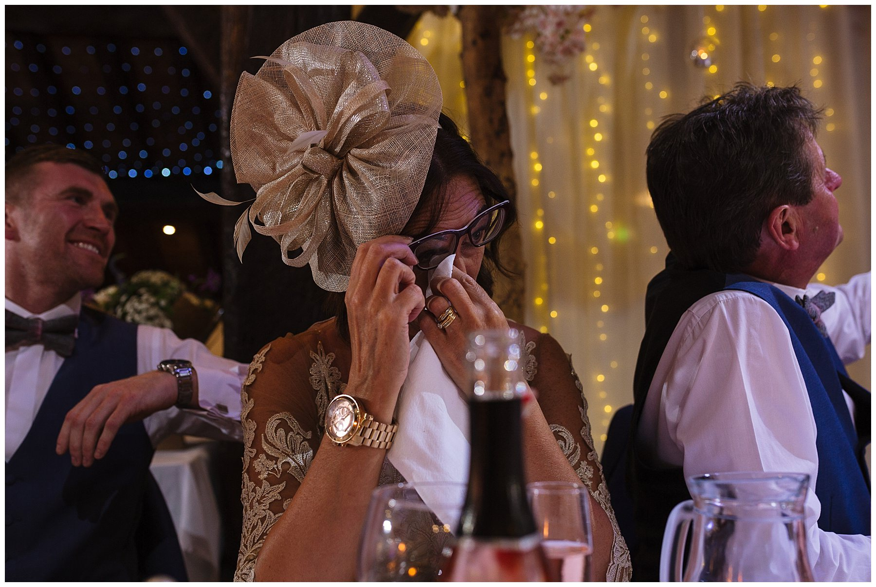 mother of the groom wipes her tears during her sons speech