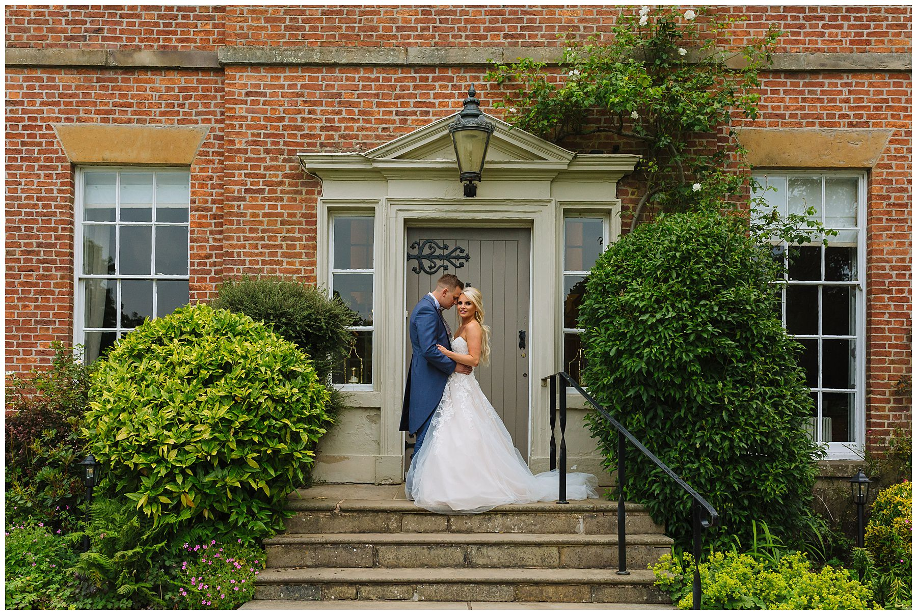 Beautiful bride and groom in front of the house at rivington barn
