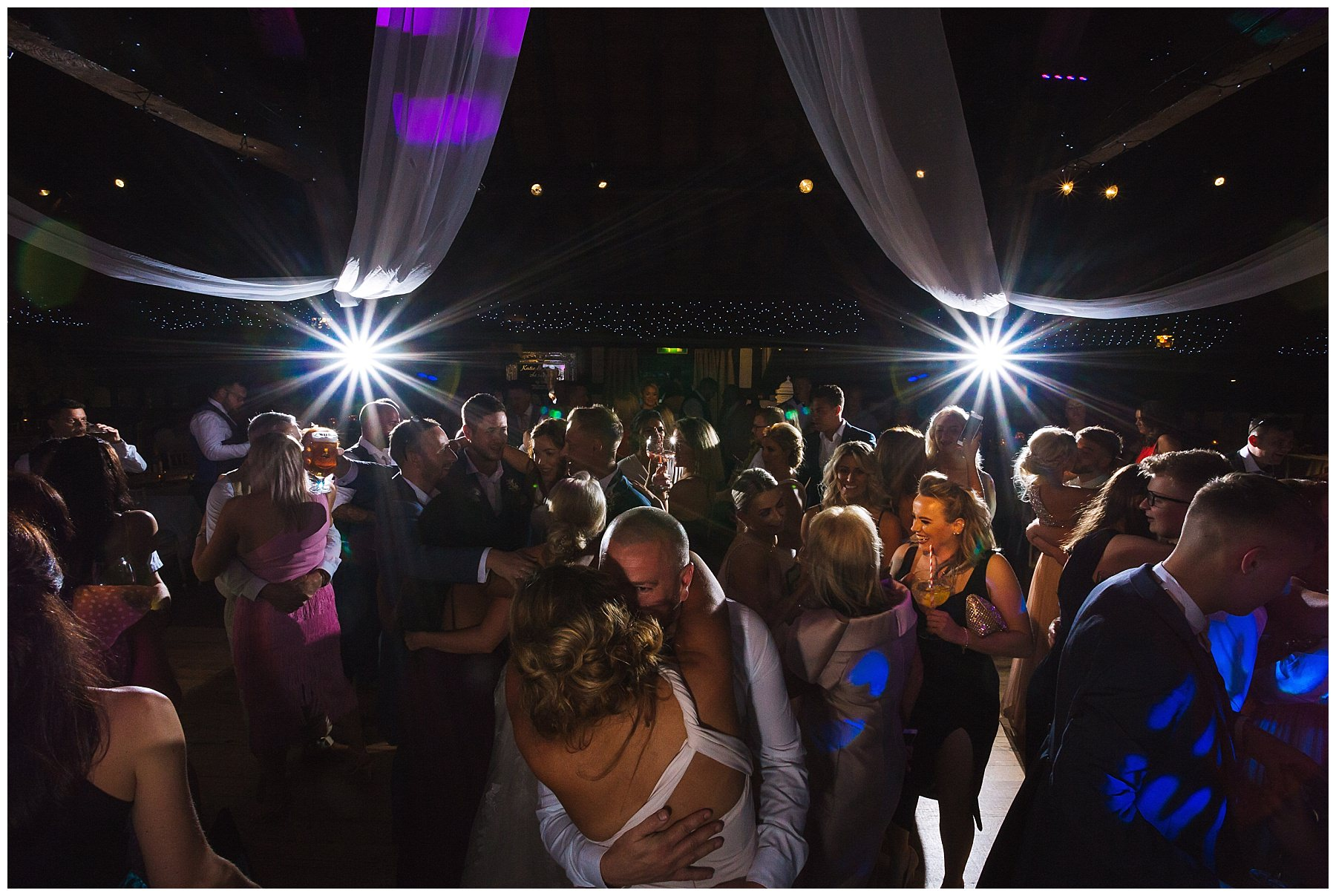 busy dance floor at rivington hall barn wedding