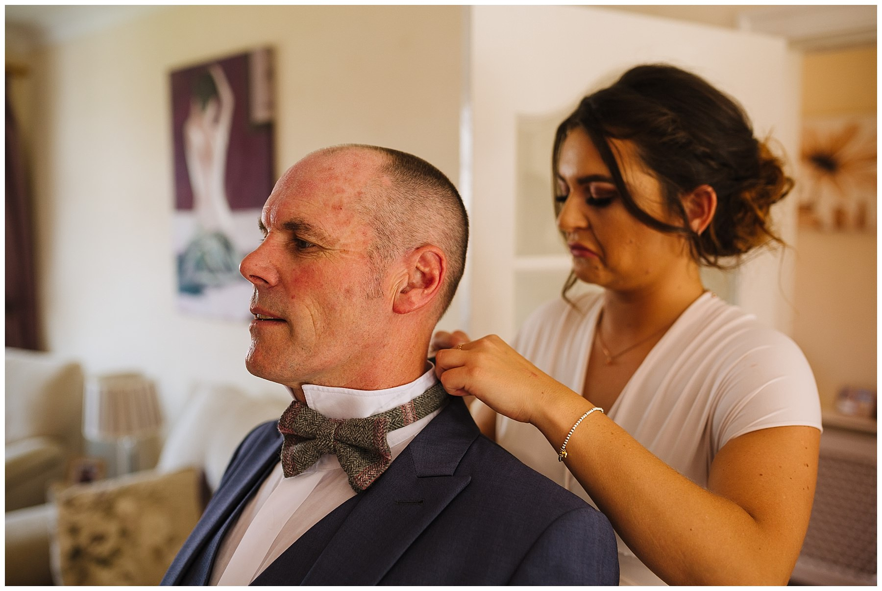 father of the bride has bow tie fastened