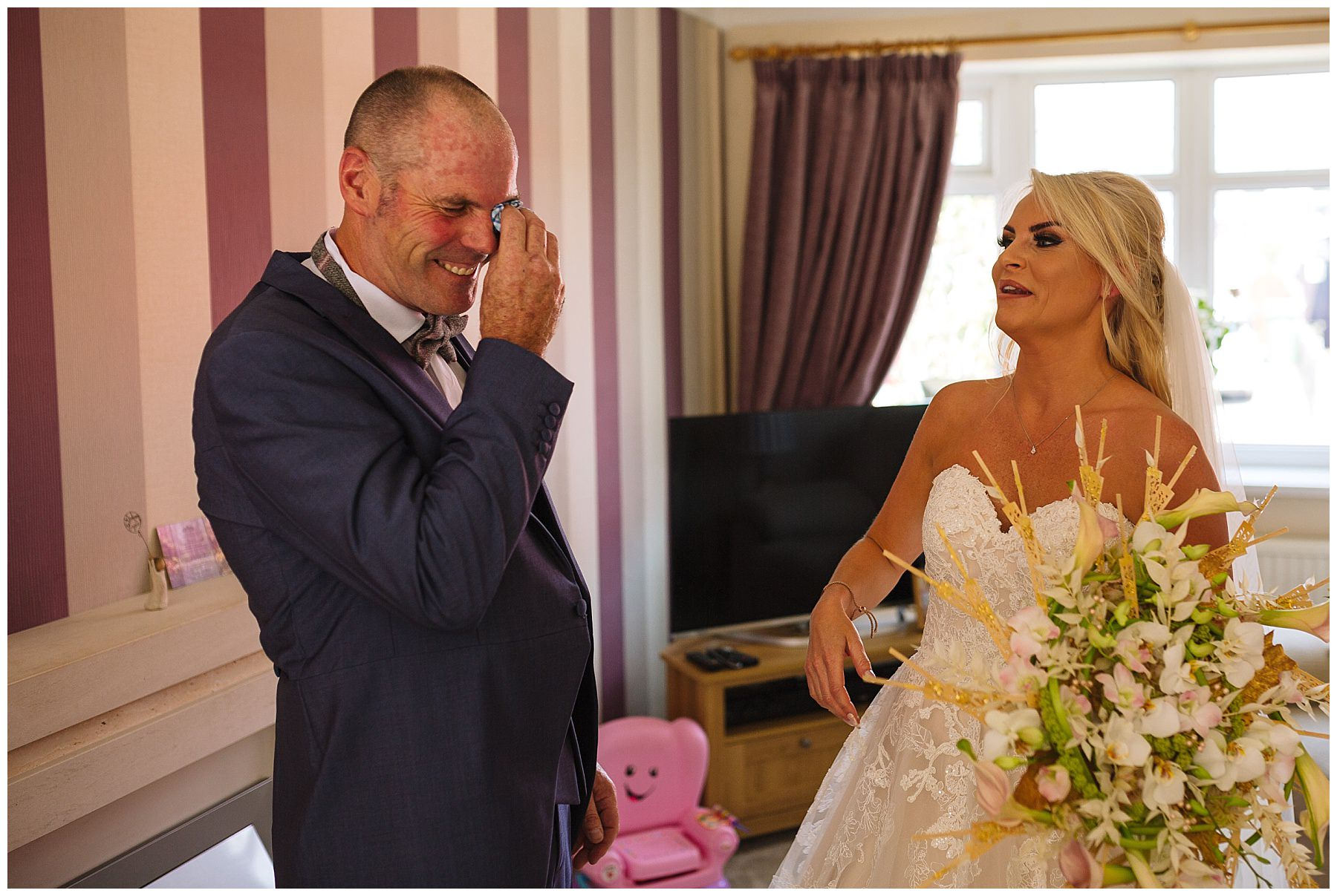 emotional father of the bride as he sees his daughter for the first time