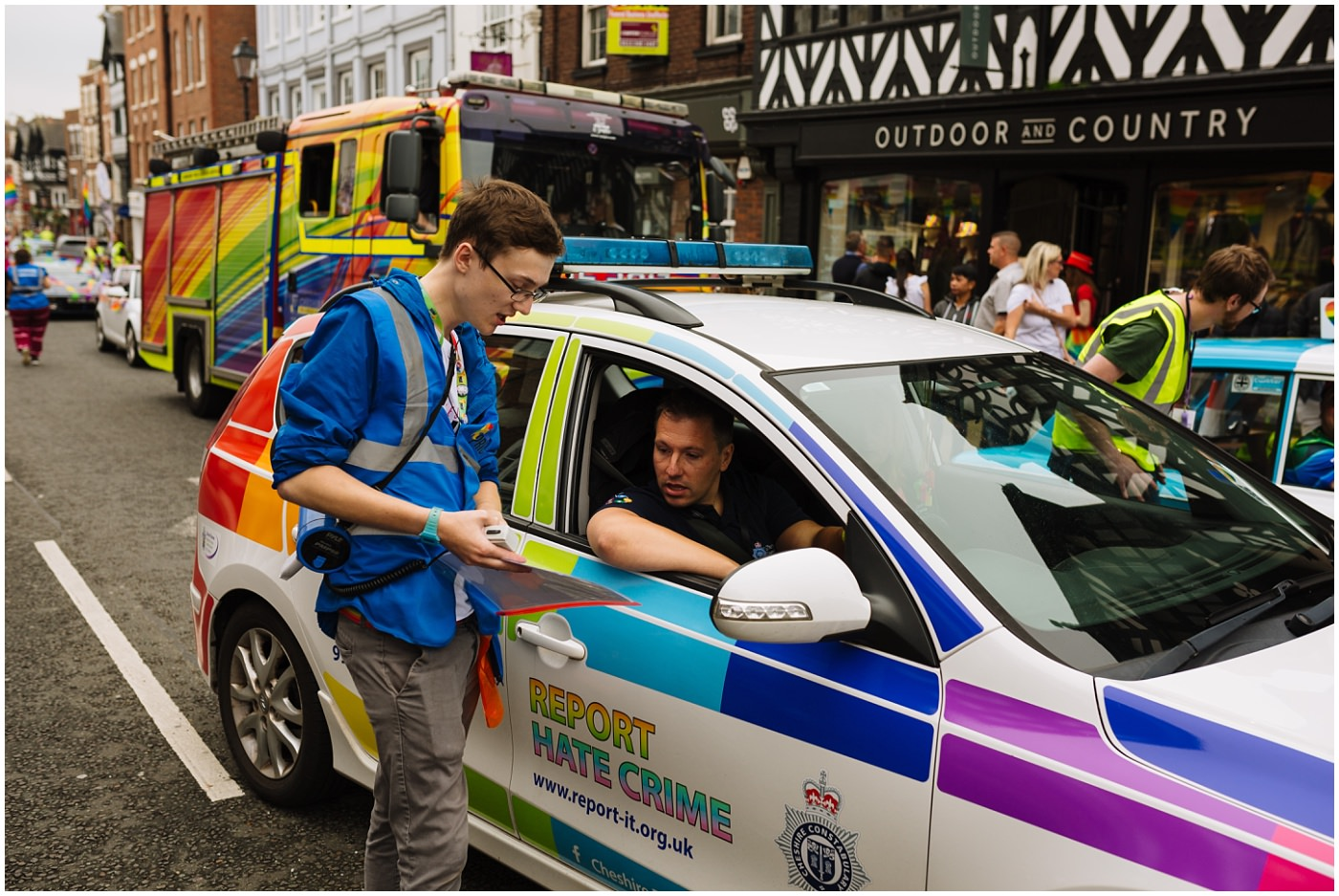 Marshal at chester pride liaises with the first car in the parade