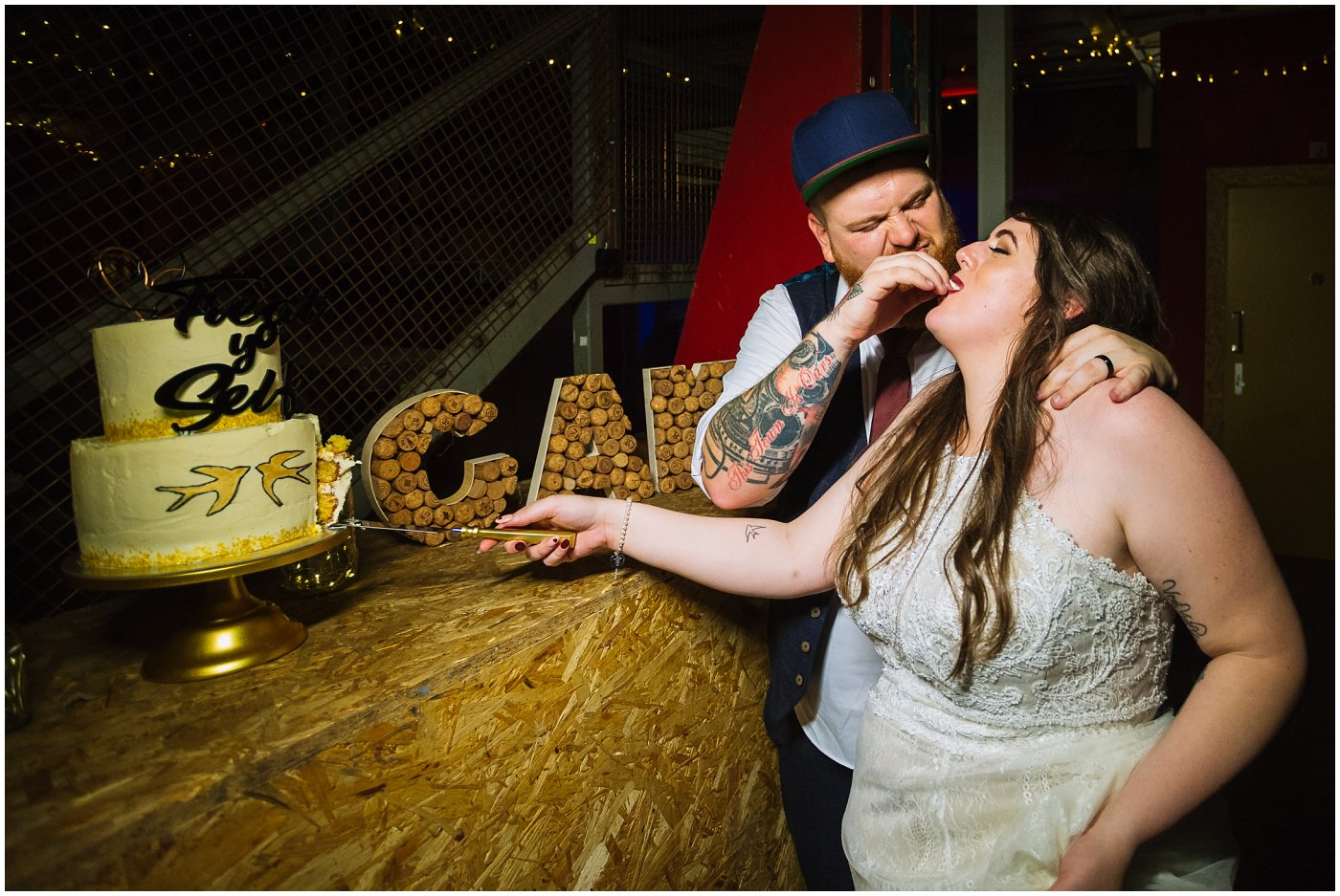 groom force feeds bride cake at manchester city centre wedding