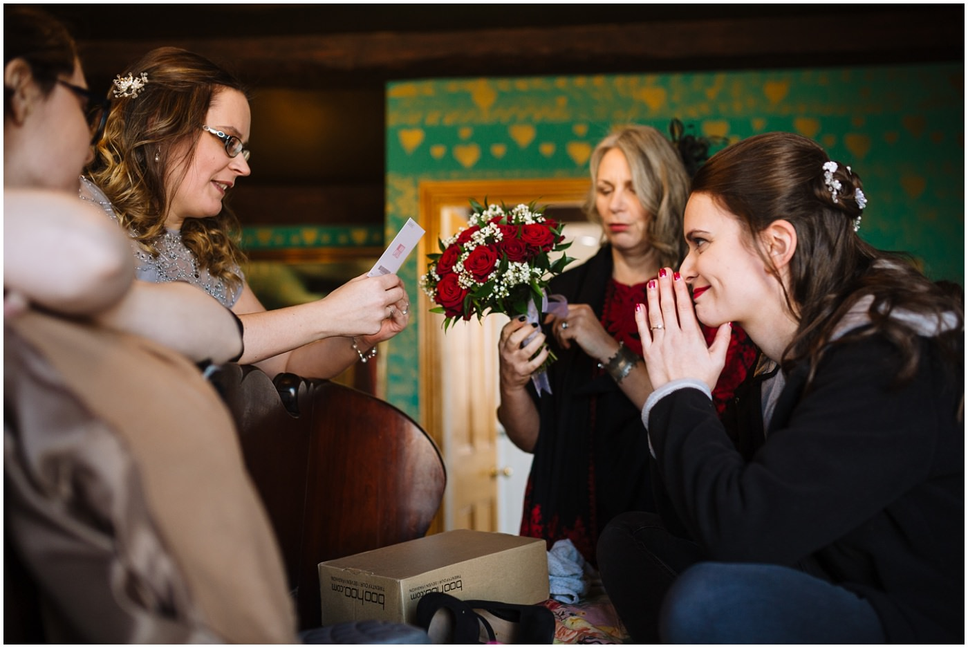 bridesmaids read wedding card to bride on the morning of her wedding