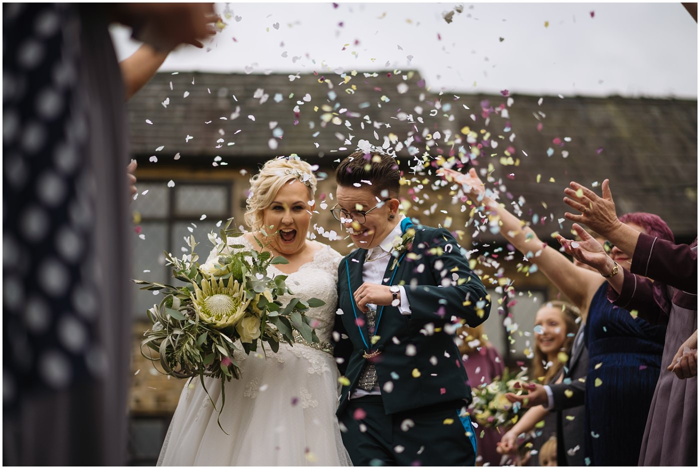 two brides showered in confetti at hyde bank farm