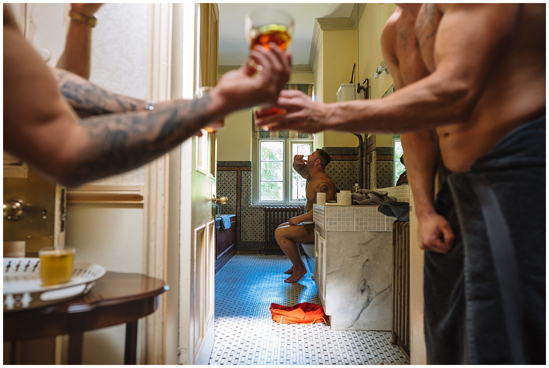 groomsmen doing shots while on toilet