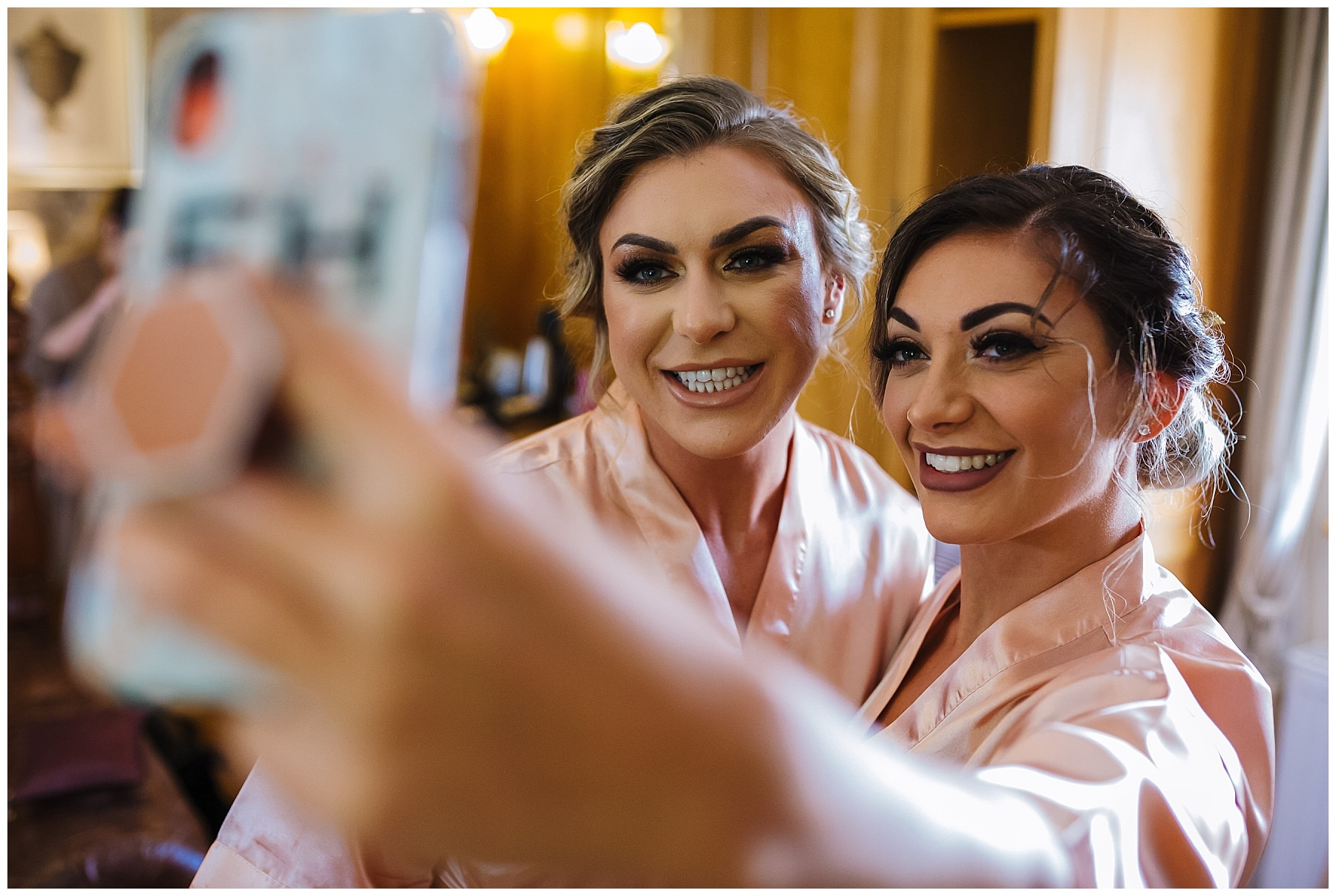 bridesmaids take a selfie during bridal prep