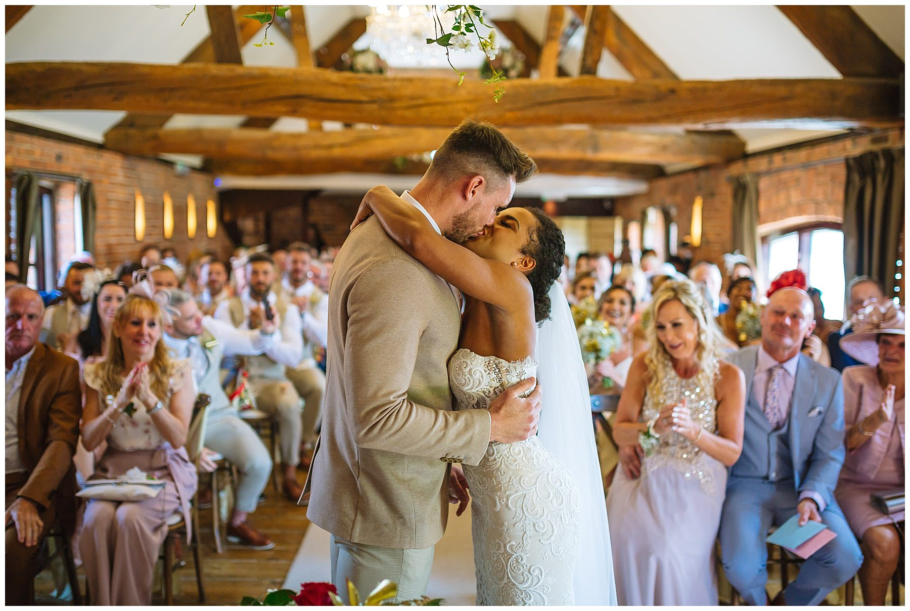 bride and grooms first kiss at swancar farm