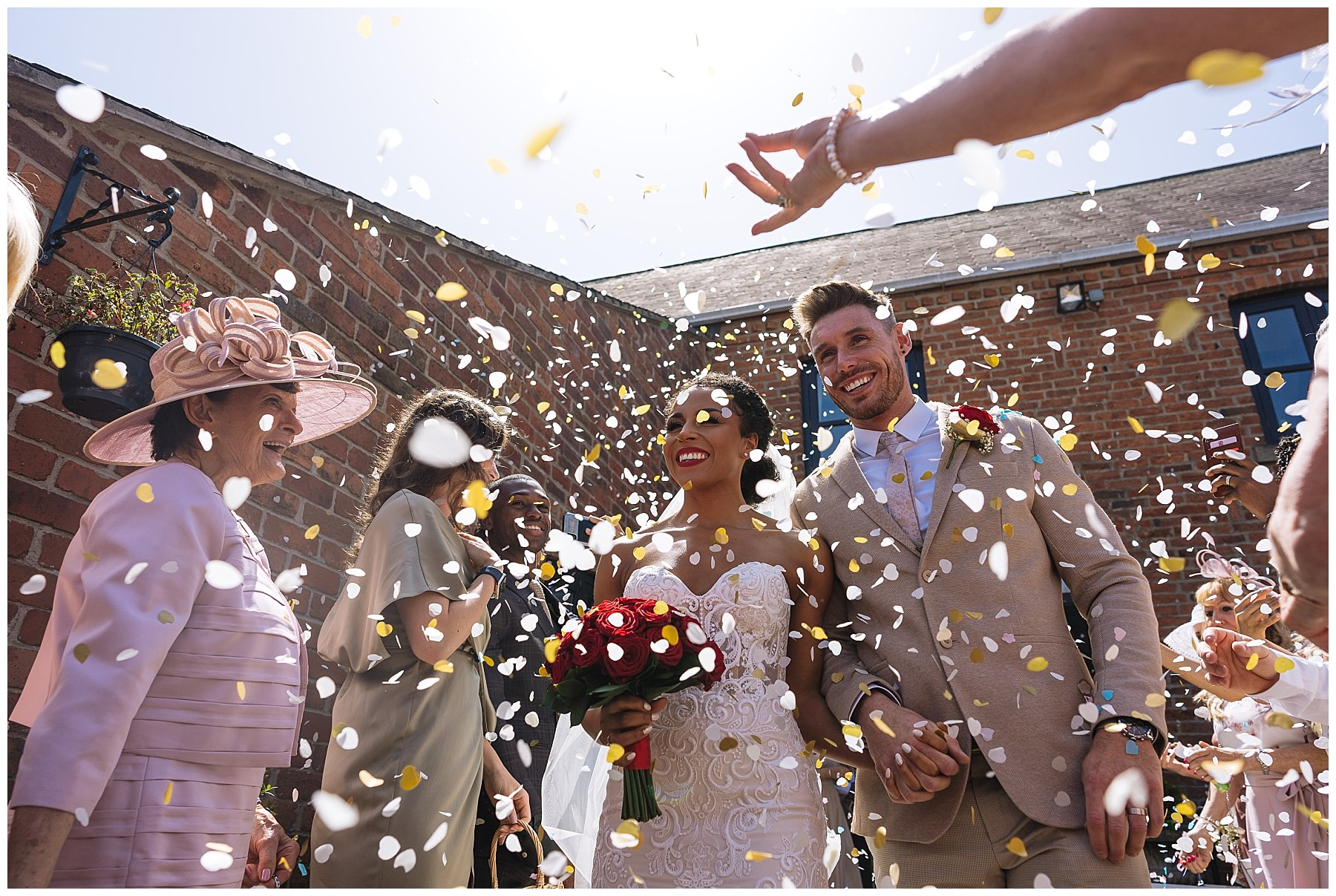 confetti thrown over bride and groom at swancar farm