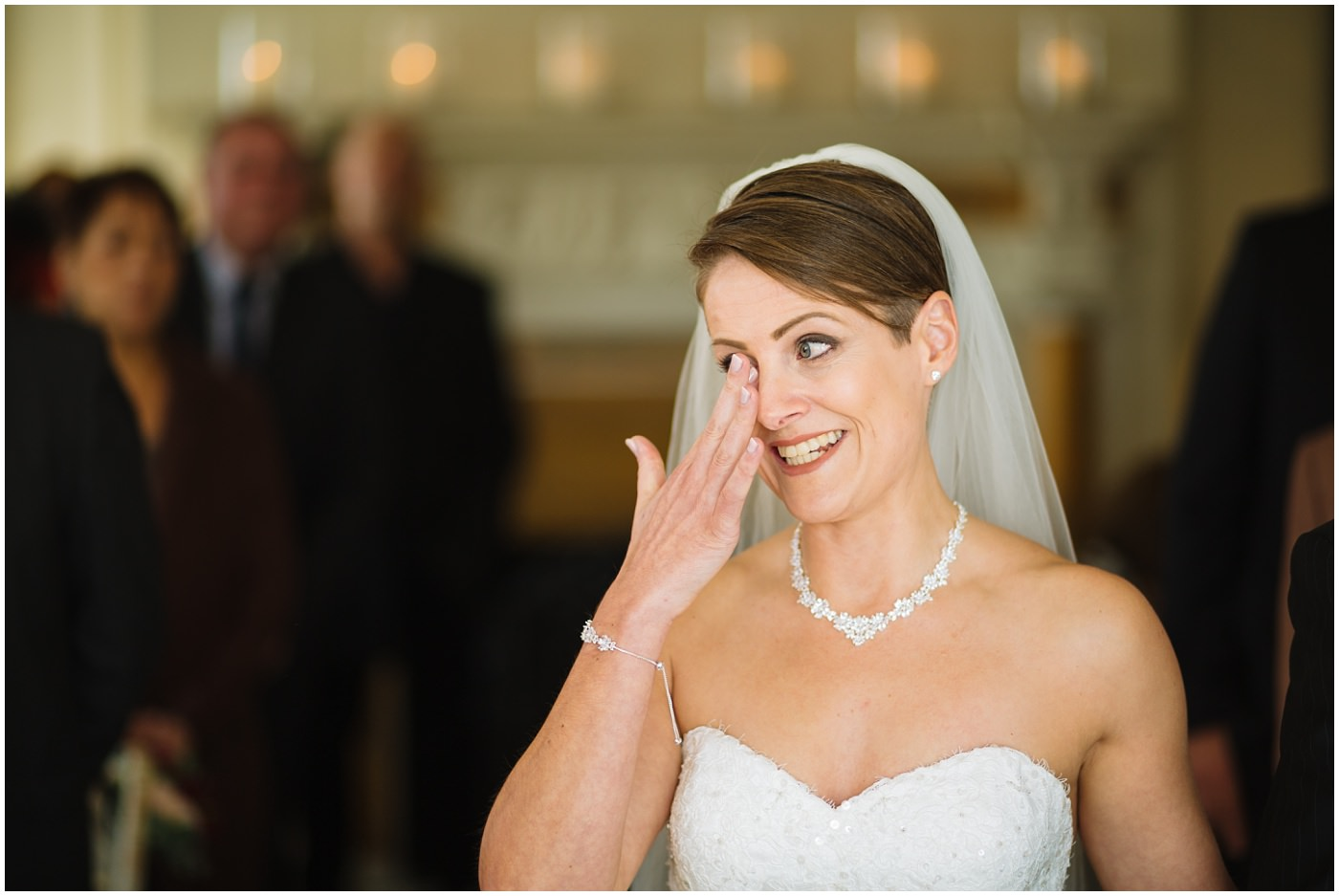 Emotional Bride during Eaves Hall Wedding Ceremony