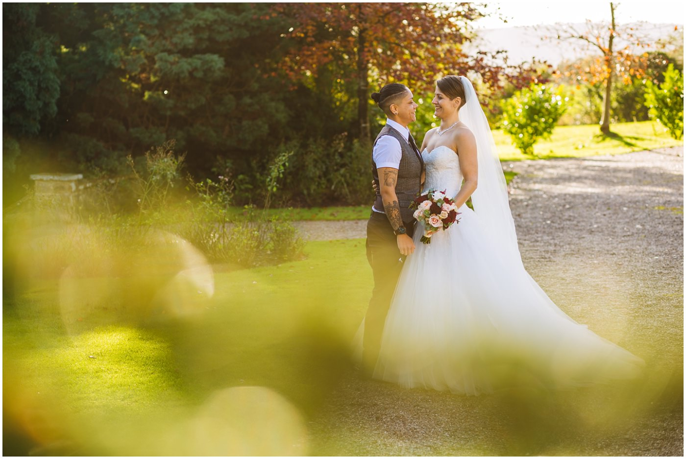 Two brides in the grounds at Eaves Hall