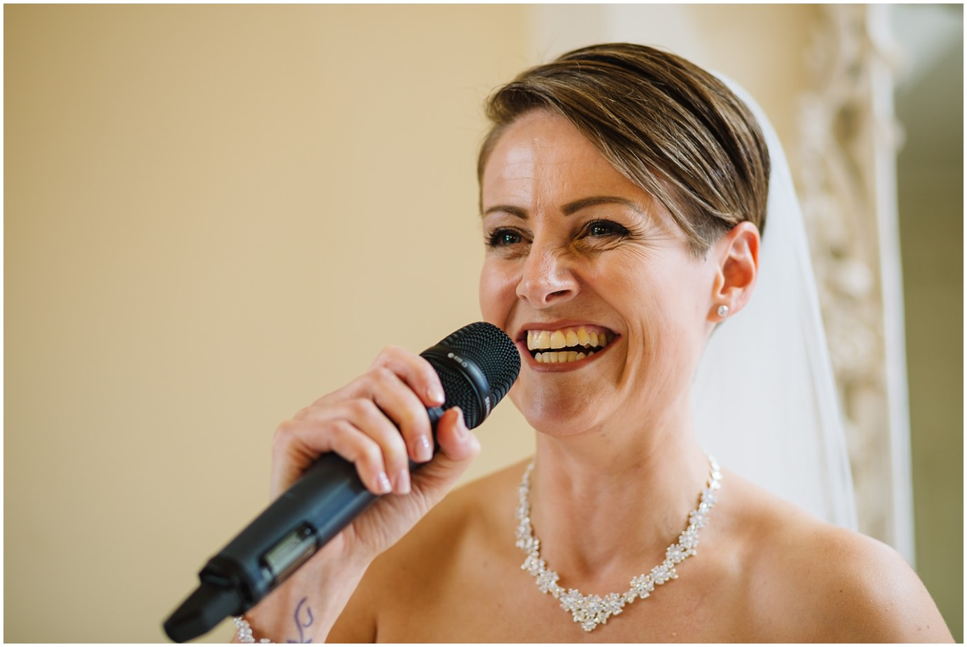 bride speaks to guests during wedding breakfast