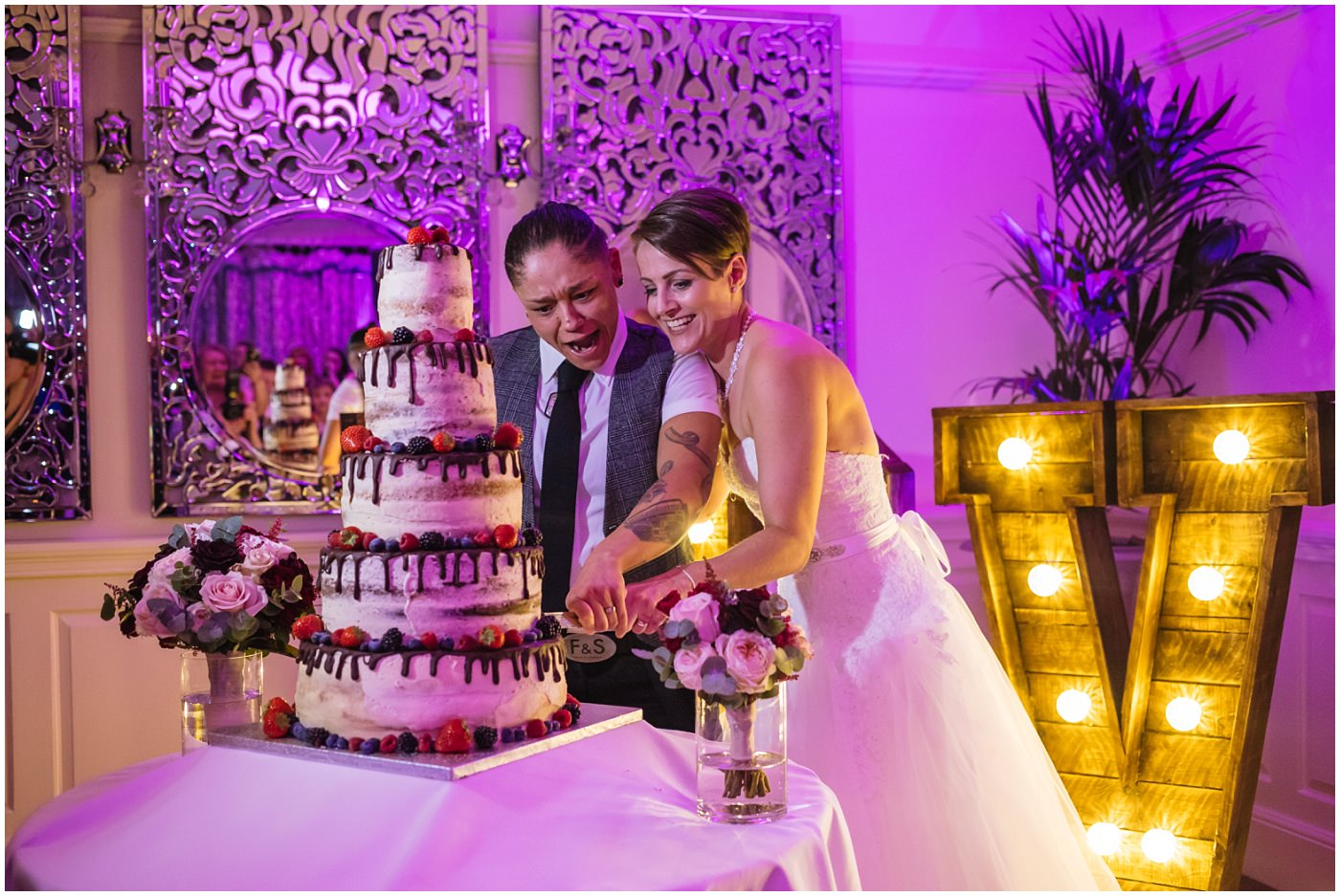 Wedding cake cut at eaves hall