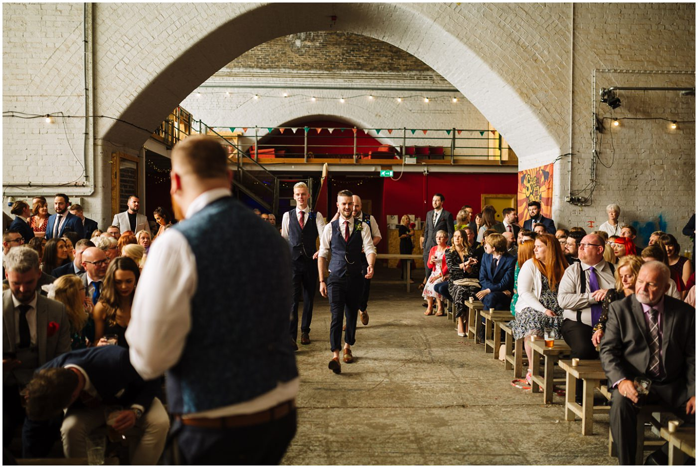 groomsmen make their entrance at fairfield social club wedding