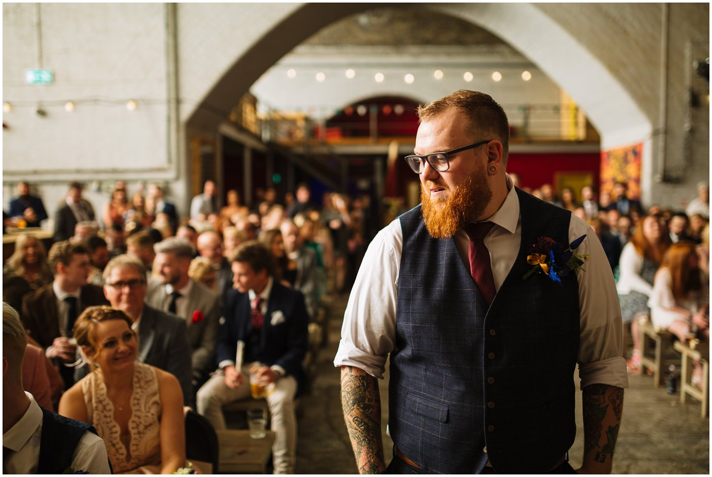 Groom waits nervously for his bride at fairfield social club