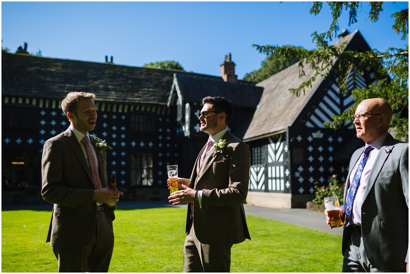 groom and groomsmen in the sun at Samlesbury hall