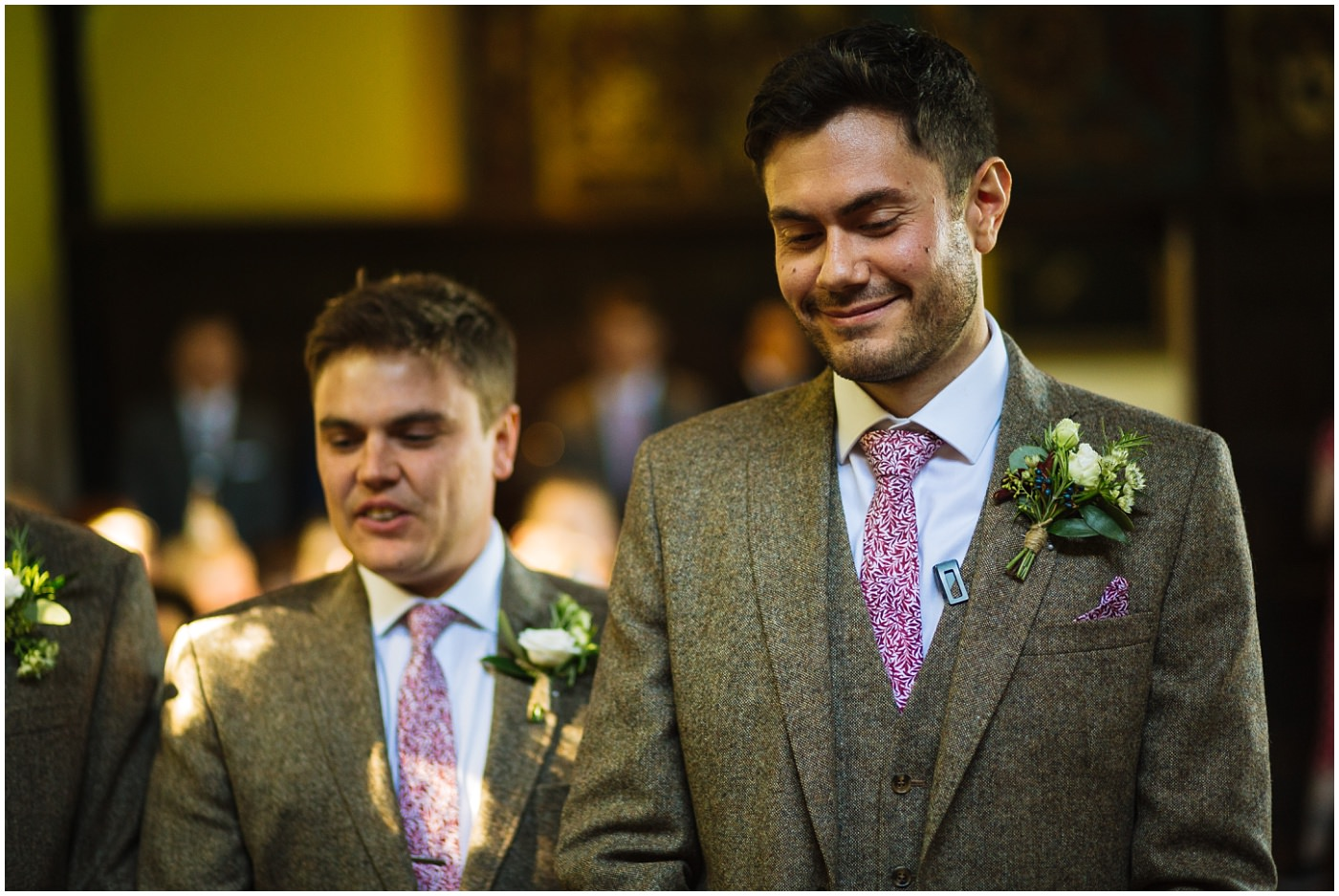groom waits nervously for his bride in the ceremony room at samlesbury hall