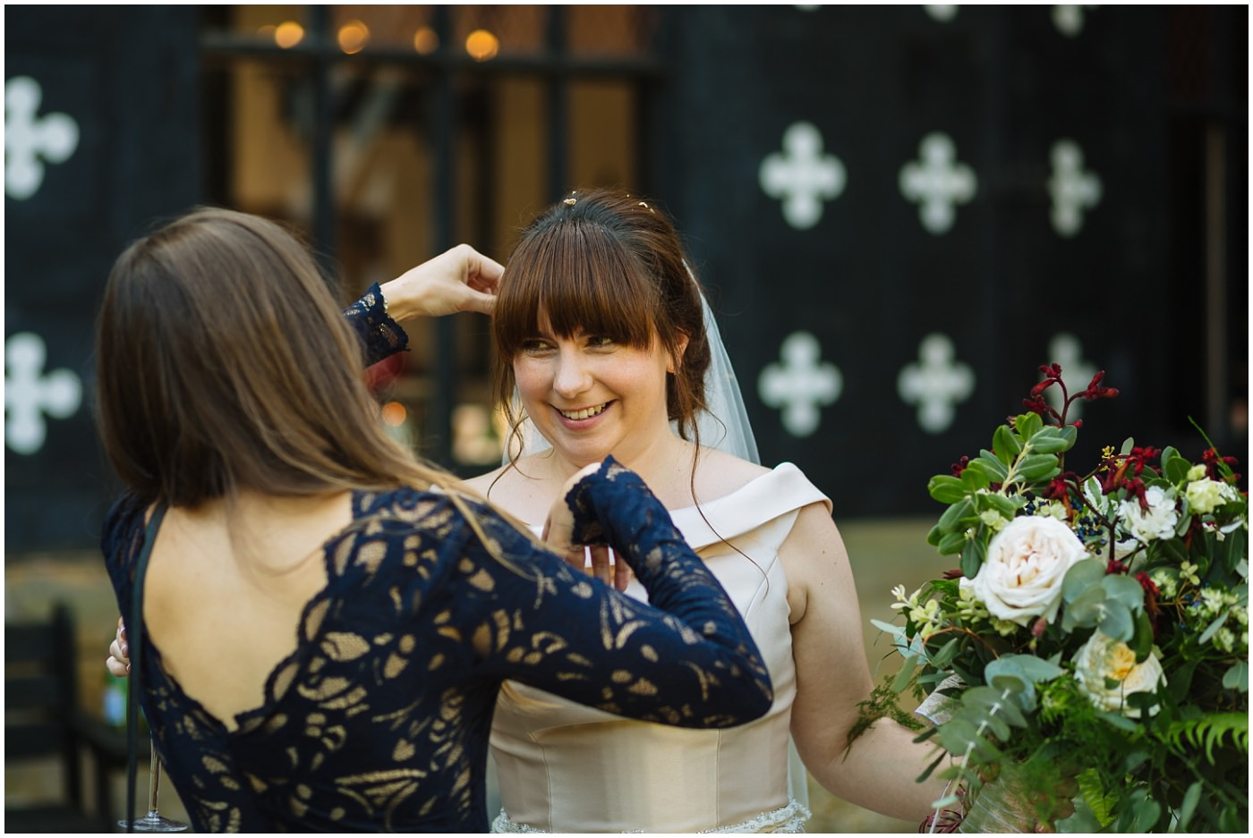 bride has confetti picked from her hair at samlesbury hall wedding