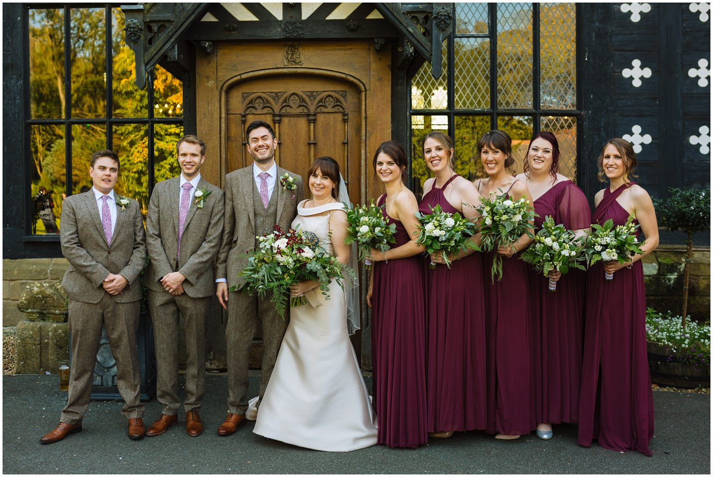 Bridal party at the front of samlesbury hall