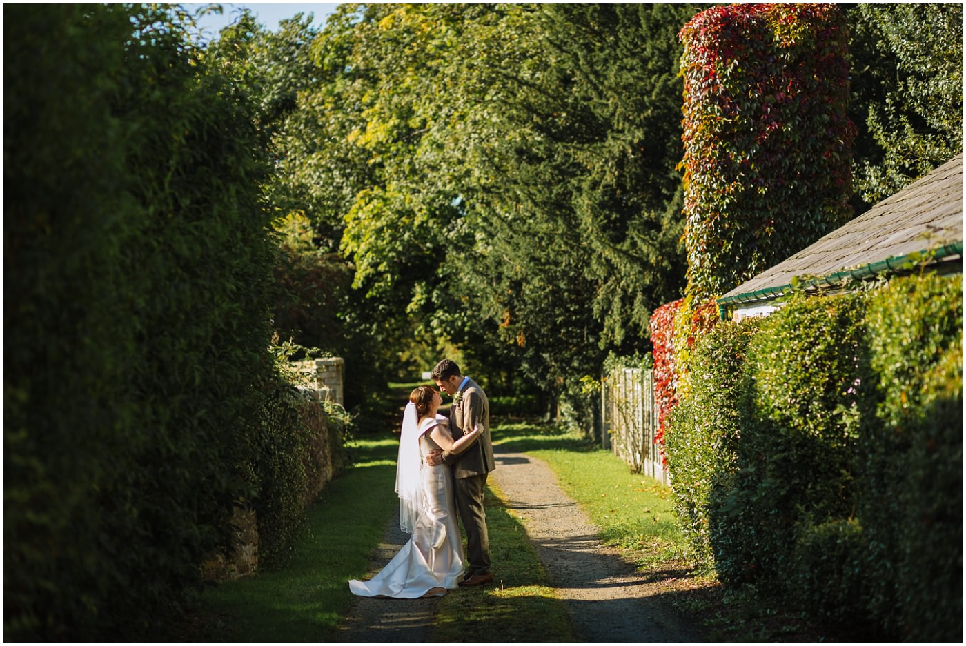 wedding couple pose in country lane at samlesbury hall