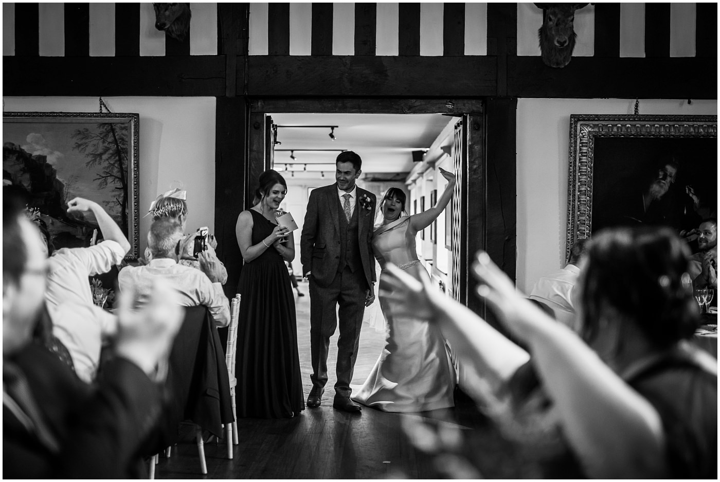 newlyweds enter the room to massive applause at samlesbury hall