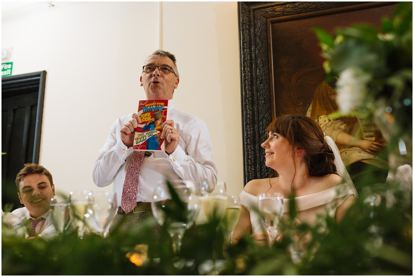 father of the bride uses a joke book to make his speech and instant hit