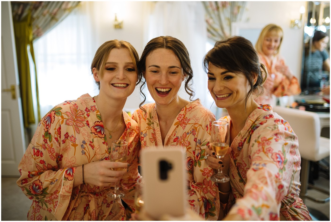 bride and bridesmaids take a selfie at sandhole oak barn