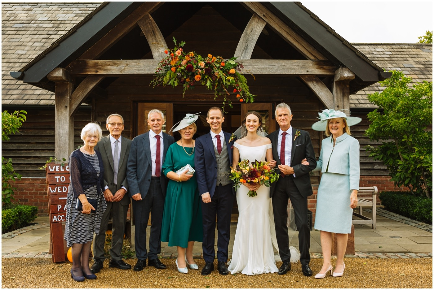 Formal family photograph outside Sandhole Oak barn