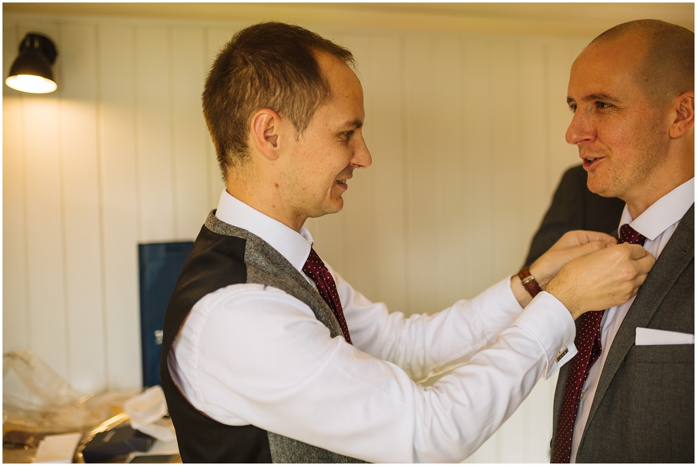 groom fixes best mans tie at sandhole oak barn