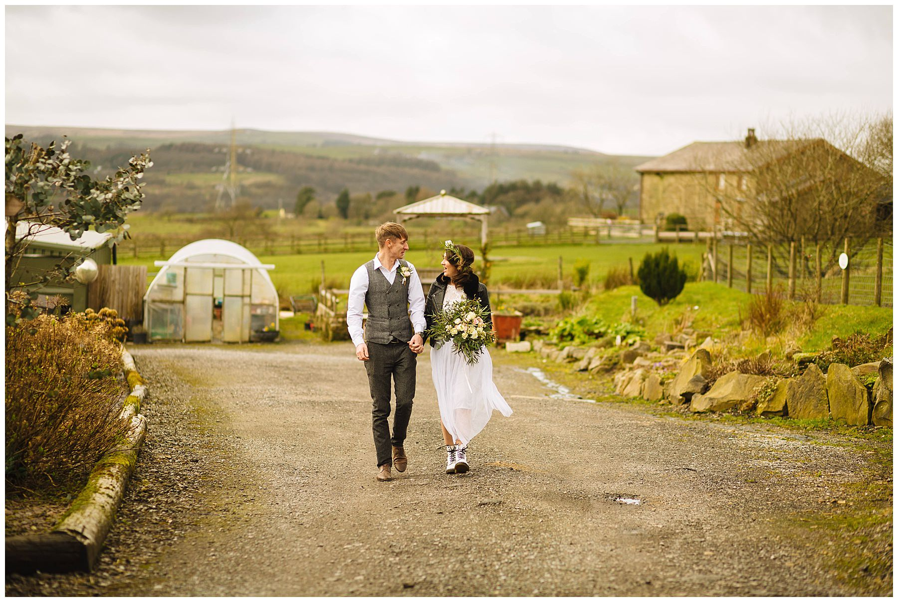 couple take a stroll through the grounds of the wellbeing farm